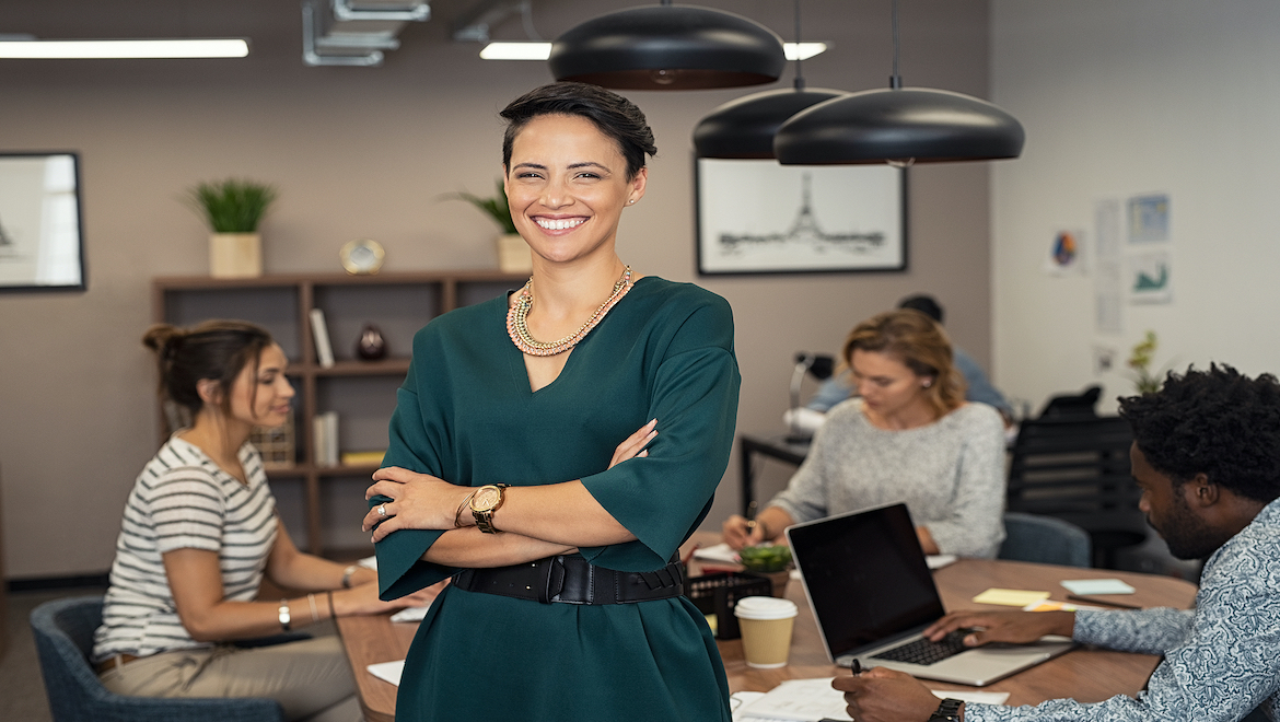 Future Minded Woman Leader Standing in Office